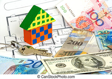 Colorful wooden house and keys on diverse currencies and...