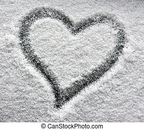 heart on snowy window