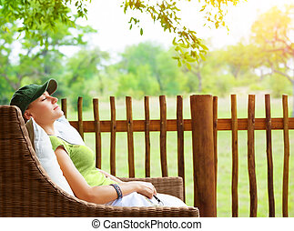 Cute girl resting on veranda, young traveler woman sleeping...