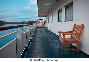 Wooden chair on the deck of cruise liner - Wooden chair on...