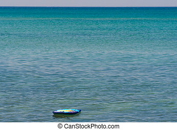 A lonely surfboard in the sea - A colorful surfboard...