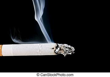 cigarette with smoke closeup - object on black - cigarette...