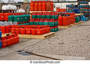 Domestic propane gas bottles in storage at a distribution...