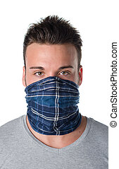Young man masked as robber or bandit - Handsome young man...