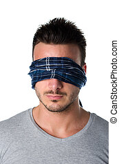 Headshot of blindfolded young man - Handsome blindfolded...