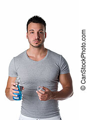 Handsome young man using mouthwash, isolated on white -...