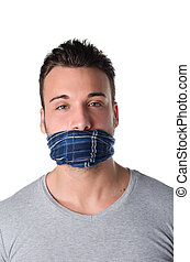 Gagged young man cannot speak - Young man with gag over his...