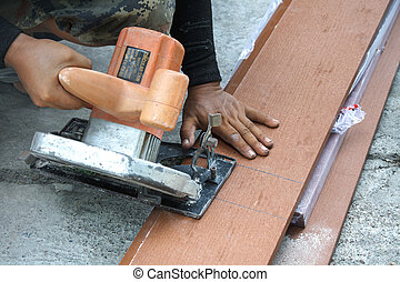 Circular saw - Workers are using a circular saw to cut wood.