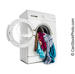 washing machine - Washing machine with clean linen on a...