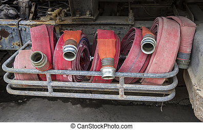 Firehose. - Firehoses and other equipment in a truck.