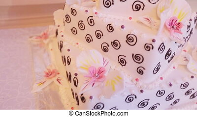Traditional wedding cake - camera follows the wedding cake...