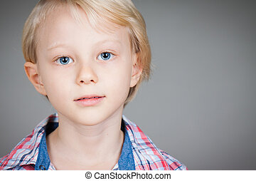 Portrait of serious young boy