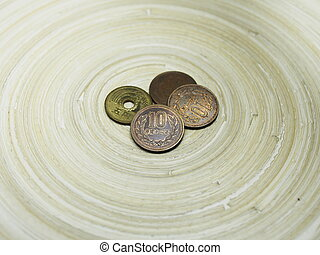 Japanese Ten Yen Coin and Other Coins on Bamboo Circular...