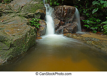 Beautiful of small waterfall flowing over the rock in the...