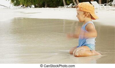 Little boy on the ocean beach