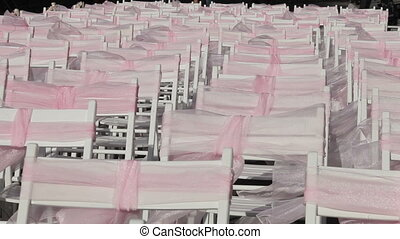 Chairs for the wedding ceremony - Rows of white chairs with...