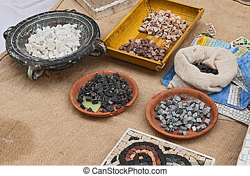 mosaic workshop, small stone tiles and material for creating...