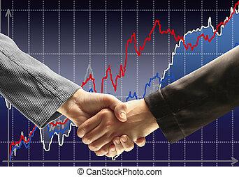Handshake - Hand holding on dark