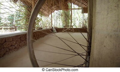old spinning wheel in the village - The old spinning wheel...