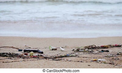 Garbage on a sandy beach - 1920x1080 video with panning -...