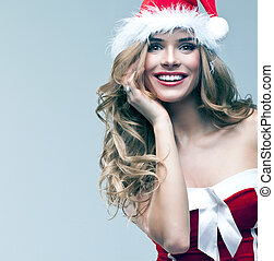 woman in Santa Claus clothes - Beautiful happy woman in...