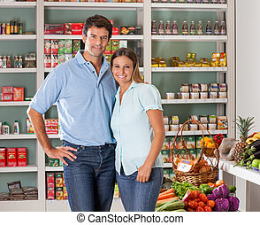 Couple Standing In Grocery Store - Portrait of mid adult...