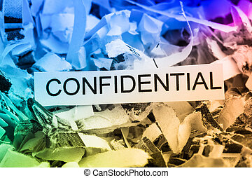 shredded paper confidential - scraps of paper with the word...