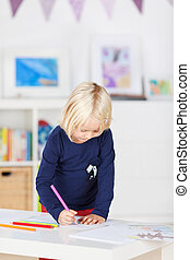 Girl Drawing On Paper At Table