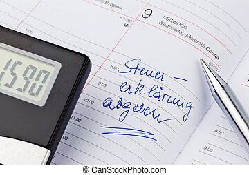 entry in the calendar: tax return - a date is entered in a...