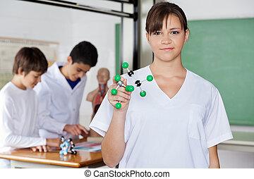 Schoolgirl Holding Molecular Structure - Portrait of...