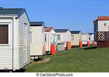 Row of caravans in trailer park, summer scene