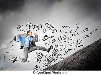Jumping young businessman - Image of jumping young...
