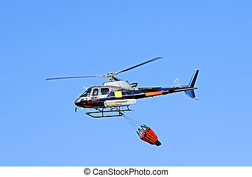 Fire fighter helicopter with a waterbag