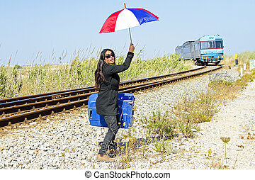 Young desperate woman at a passing train