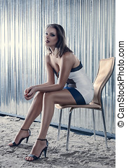 Sensual woman - Fashion young woman sitting on chair outdoor...