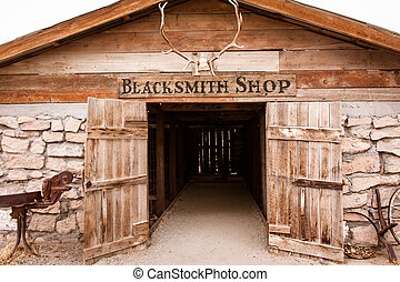 Blacksmith shop - Front of an old western wooden blacksmith...