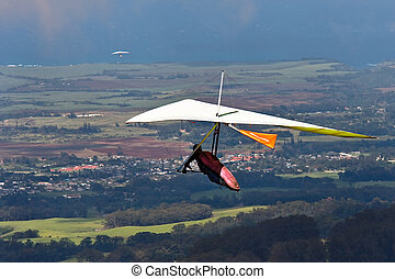 Hang Glider  - Hang glider taking off in Maui Hawaii.