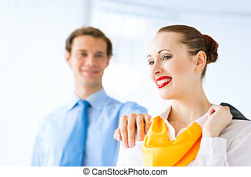 young successful business woman smiling, a colleague put his...