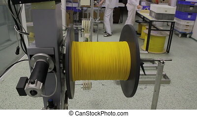 reel with fiber optic cable on winding machine