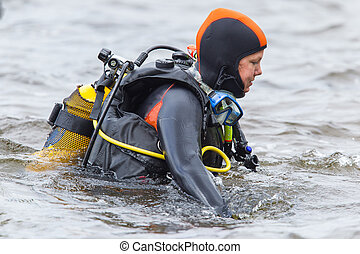 Scuba gear, woman - Close-up of a woman, scuba-diver gear