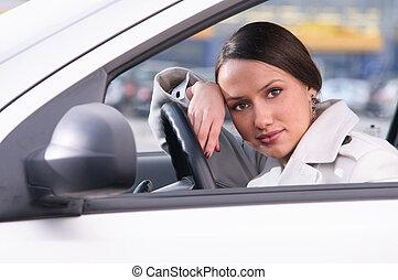 woman in car - beautiful sensual woman put her head on...
