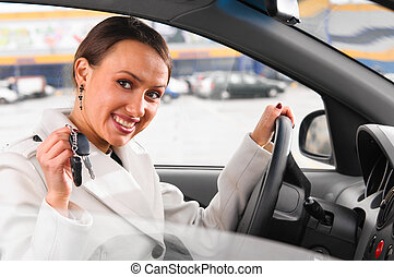 keys of new car - happy woman is showing keys of her new car