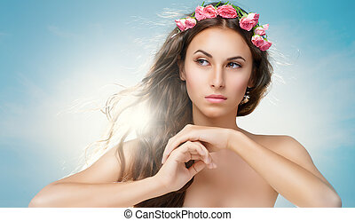 flower girl - beauty woman on the sky background