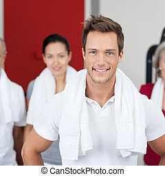 Young Man Smiling With Group In Gym