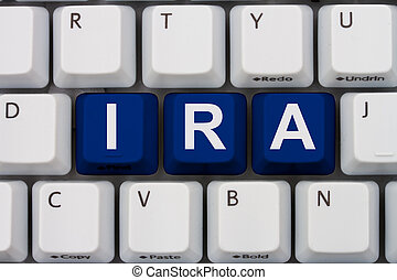 Online Investments - Computer keyboard keys with word IRA,...
