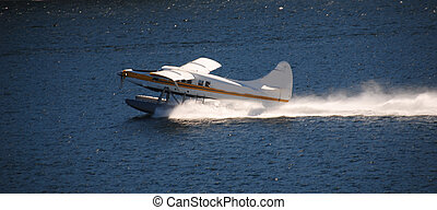 float plane takes of on the water