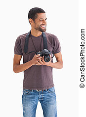 Smiling man with camera around his neck on white background