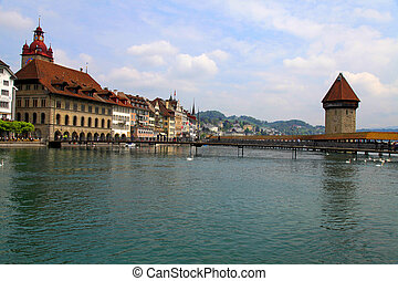 Chapel Bridge and Waterfront of Reuss river, Lucerne, Switzerland. Chapel Bridge is the oldest wooden bridge in Europe, originally built in 14th century.
