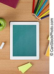 Digital tablet over a school desk - Digital tablet with...