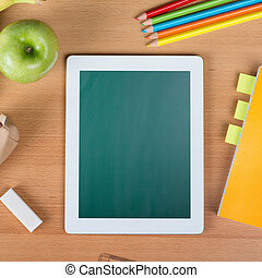 Digital tablet over a school desk - Digital tablet with...
